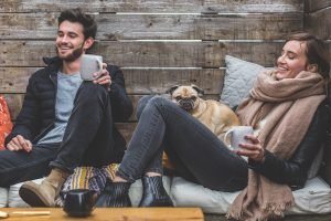 couple and a dog sitting and laughing