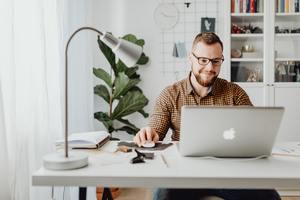 IT Entrepreneur working on laptop in Canada