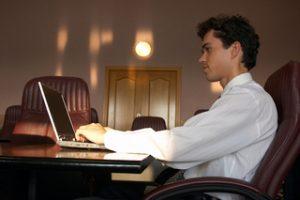 Tech worker on laptop in Canada