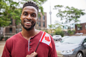 Man holding a Canadian Flag in Toronto
