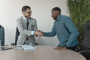 two men shaking hands after a successful job interview