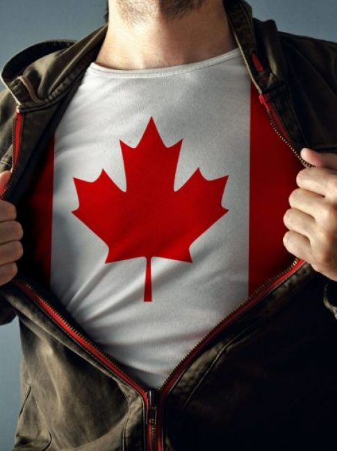 Man opening his jacket to reveal a t-shirt with the Canadian flag on it